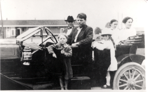 Bobby Dunbar (behind car door) with unknown persons